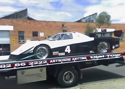 Race car being towed interstate
