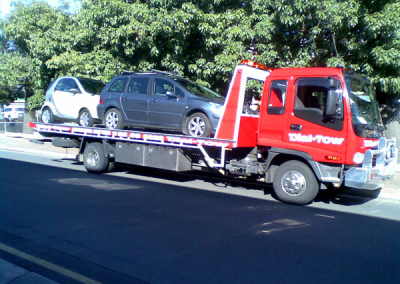 Two cars being towed