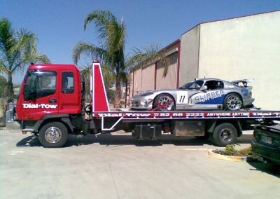 Towing a clipper on our state-of-the-art tilt truck