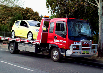 Towing a mini vehicle on one of our tow trucks