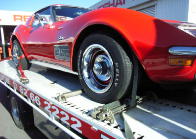 A Corvette being towed to it's owner's new home interstate