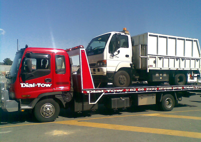 A rubbish truck, that broke down while on job, being towed to the repair workshop