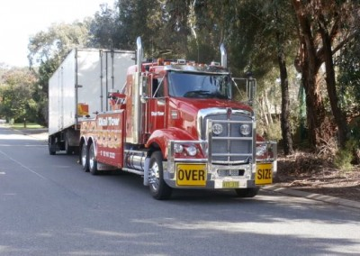 Towing an oversize truck on our tilt trucks