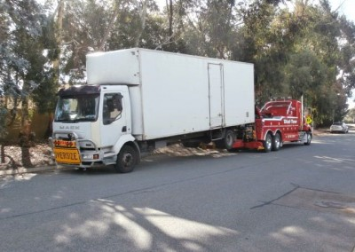 Towing an oversize truck on our tilt trucks