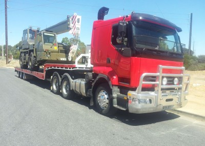 Crane transport using one of our low-bed trailer tow trucks