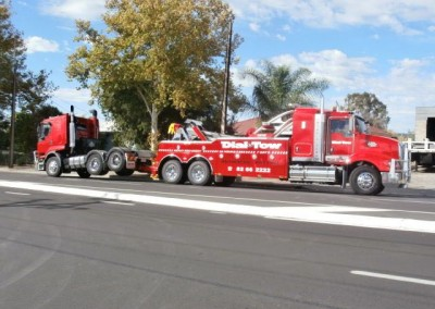 Towing a trailer interstate on Dial-a-Tow's tilt trucks