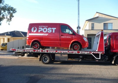 Towing an Australia Post Van on one of our tilt trucks