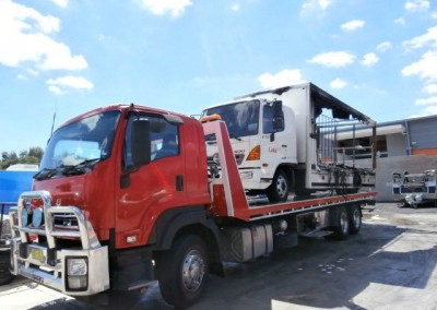A burnt out truck loaded on to our tilt truck for interstate towing to a repair workshop