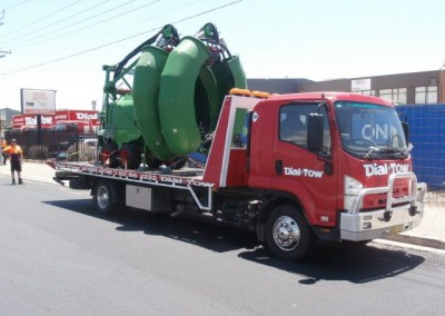Towing heavy machinery on Dial-a-Tow's interstate tow trucks