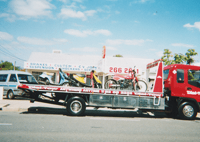 Towing multiple motor-bikes on Dial-a-Tow's motorbike transportation truck