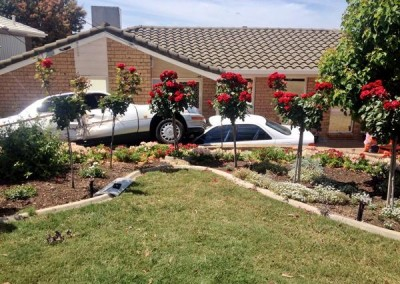 Recovering a car stuck on top of another in a South Australian home's driveway