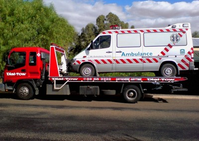 Attending to an emergency ambulance breakdown, towing it to a service depot locally