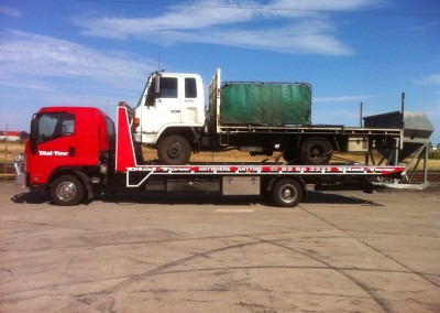 A truck being towed in one of our heavy vehicle tow trucks